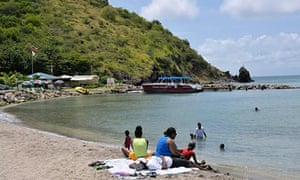 Tourists on the beach at Frigate Bay South, St Kitts.