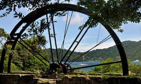 Waterwheel with blue water behind near Speyside.