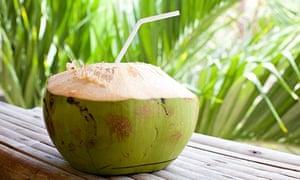 Fresh coconut with straw.