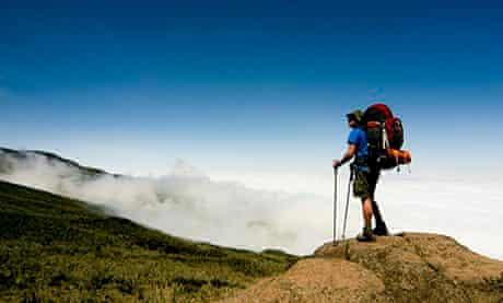Hiker overlooking Mount Kilimanjaro