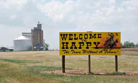 Road sign welcoming people to Happy, Texas, USA