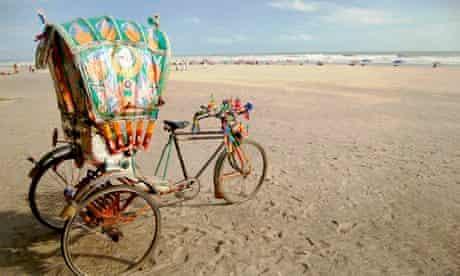A rickshaw on a beach in Bangladesh