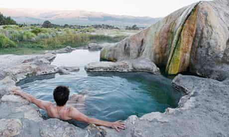 A woman sits alone in Travertine Hot Spring