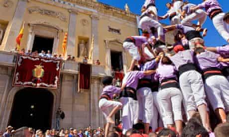 'Castellers' building human tower, a Catalan tradition.