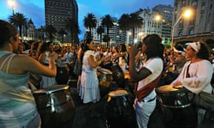 Women play and dance candombe