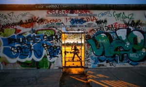 A door at a painted section of the East Side Gallery in Berlin