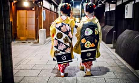 Two Geishas walking together in Kyoto.