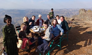 Family dinner on cliff in Ethiopia