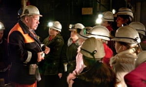 A former miner giving school pupils an underground tour at Big Pit National Coal Museum Blaenavon