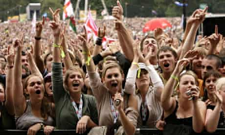 Festival crowd with hands raised