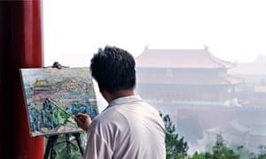 An artist in Jingshan Park, Beijing, paints the Forbidden City through the smog.