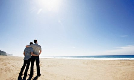 Gay couple standing on a beach