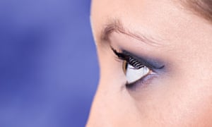 Close up of a young woman looking away wearing blue eyeshadow. Image shot 2008. Exact date unknown.