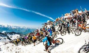 Riders take part in Megavalanche at Pic Blanc, Alpe d'Huez, France