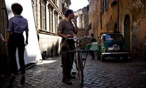Actors on the set of a movie being filmed in the Monti neighbourhood, Rome, Italy