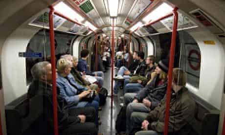 Passengers sitting on London underground tube train