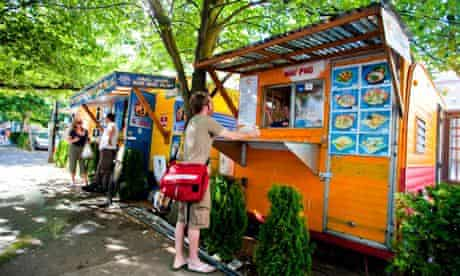 Customers at food carts at the SW 9th & Alder pod.