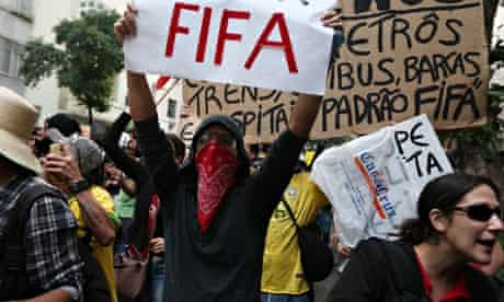 Protestors Rally In Rio On First Day Of 2014 World Cup