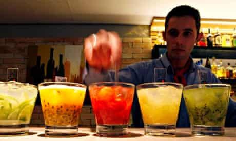 A barman prepares caipirinhas, a cocktail made with cachaça, in a restaurant in São Paulo