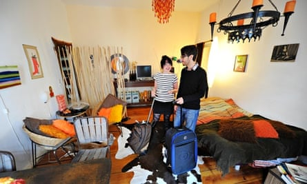 Couple stand in an Airbnb apartment in Berlin