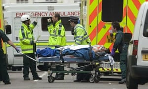 Emergency workers with a casualty injured in the 7 July 2005 bombings in London