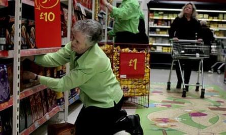 Older female employee working at the supermarket,Asda