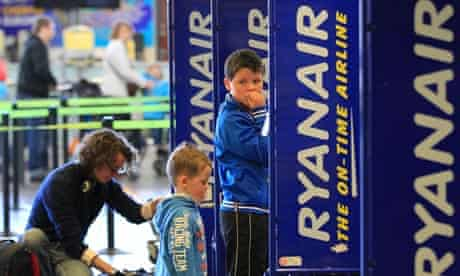 People queue at the Ryanair check-in desk at Dublin International airport