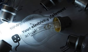 Domestic electricity bill on a desk surrounded by light bulbs