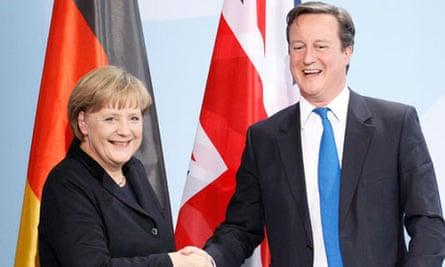 German Chancellor Merkel and Britain's Prime Minister Cameron shake hands in Berlin