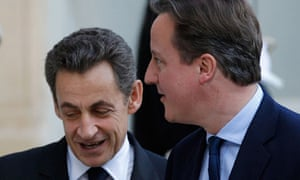 France's President Sarkozy greets Britain's Prime Minister Cameron at the Elysee Palace in Paris