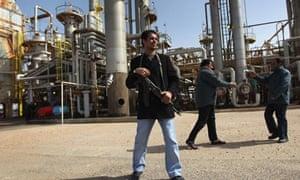 Guard at Libyan oil refinery