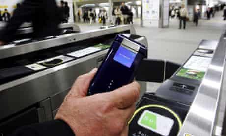 Mobile phone wallet in use in Japan