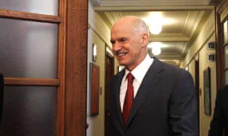 Greek PM Papandreou arrives at a cabinet meeting in Athens