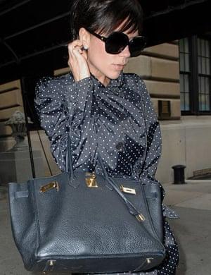 Victoria Beckham with a Hermès handbag.