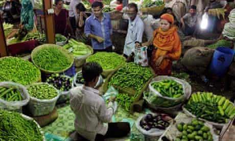 Indians shop for vegetables at a market in Ahmedabad