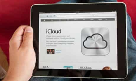 iPad user looks at Apple's iCloud remote-storage service