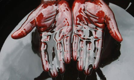 Protester with hands covered in oil