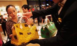 A woman shops in a Louis Vuitton store in Shanghai