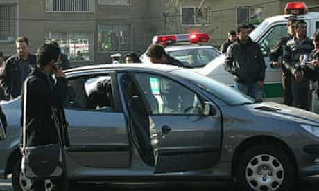 Iranian police beside the car in which Majid Shahriari was killed