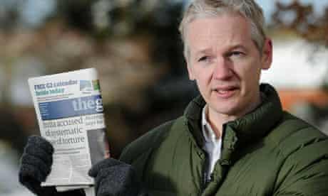 WikiLeaks founder Julian Assange holds the Guardian