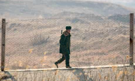 North Korean soldier behind border fence