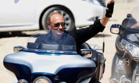 Vladimir Putin waves riding a Harley Davidson near Sevastopol