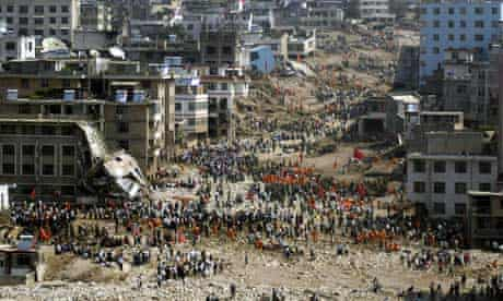 Chinese rescuers search for survivors in debris after a deadly landslide hit Zhouqu, China