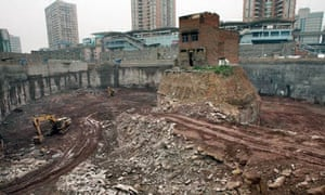 A house belonging to a Chinese family who refused a compensation deal by a developer