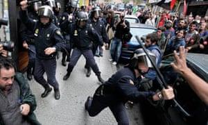 Spanish police break up a picket line that had entered a shop in Santiago de Compostela, Spain
