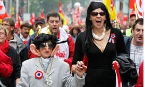 Demonstrators portraying France's President Sarkozy and wife Carla take part in the protest, Belgium