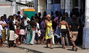 Resident queue for bread in streets of Mozambique