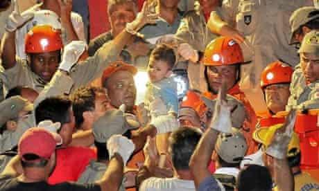 6-month old  baby Nicolas Guimaraes is rescued from the mudslide in Nova Friburgo, Brazil