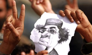 Libyan protesters hold a caricature of  Muammar Gaddafi during a rally in Tobruk