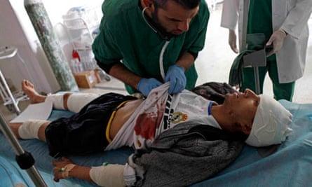 An injured Libyan rebel arrives at a hospital in Ras Lanouf